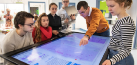Photo Source: University of Eastern Finland students using large touch screens to analyse virtual tissue samples